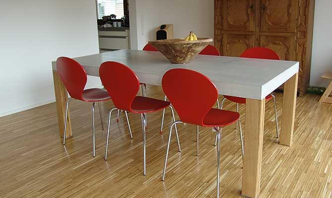 esstisch aus beton holz edelstahl form in funktion. Black Bedroom Furniture Sets. Home Design Ideas